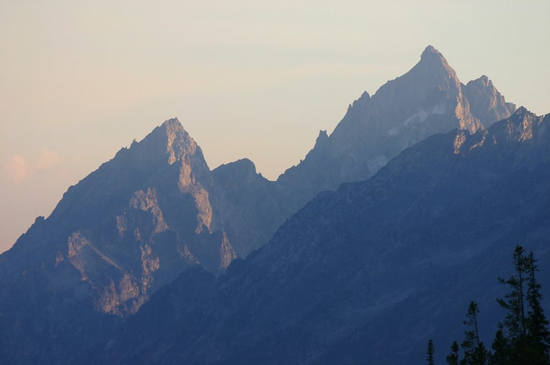 Tall, pointed mountain peaks on a hazy day