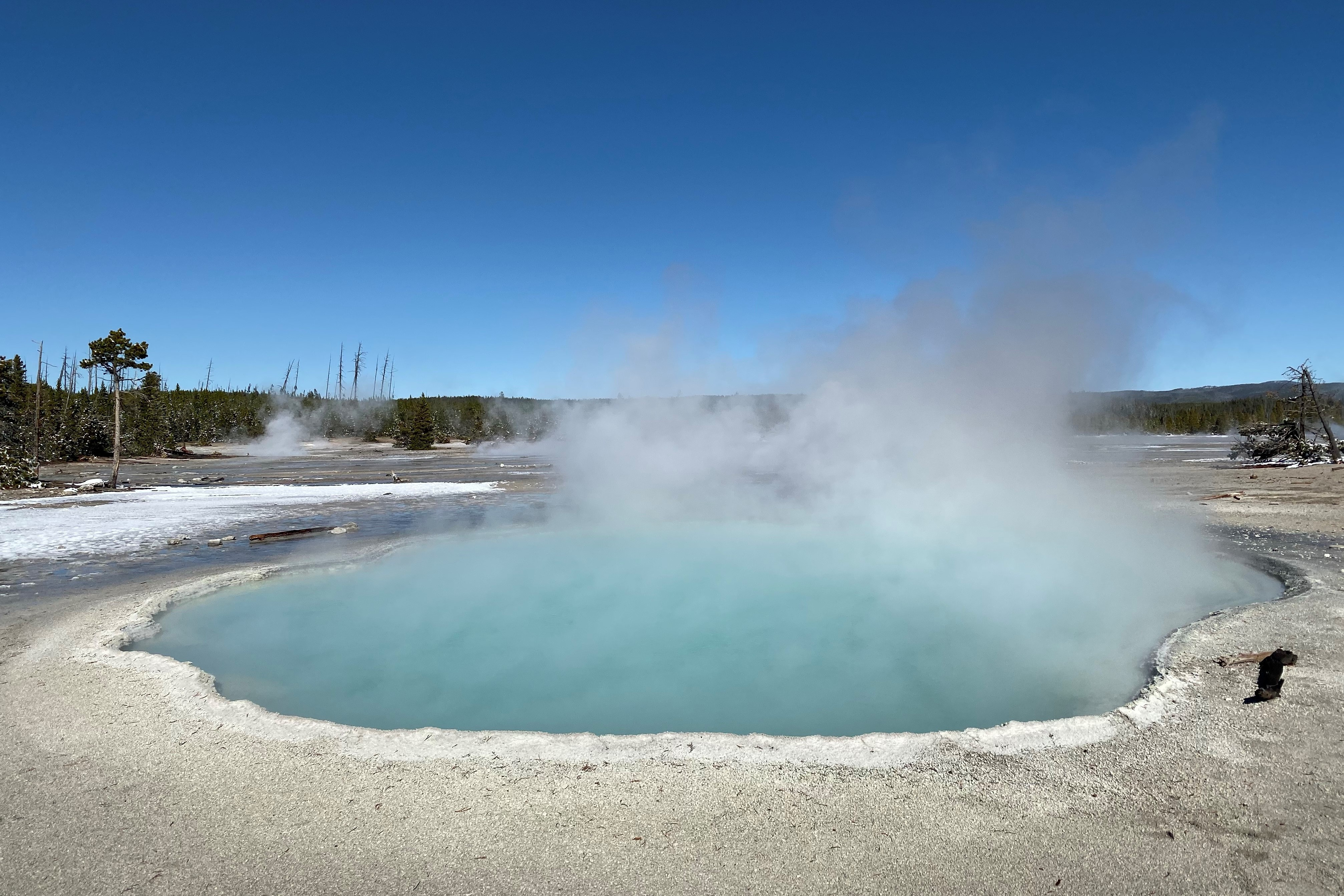 Bubbling, steaming, blue hot springs pool